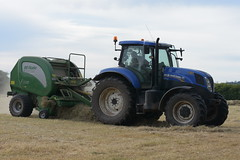 New Holland T7.200 Tractor with a McHale F5500 Round Baler (Shane Casey CK25) Tags: new holland t7200 tractor mchale f5500 round baler nh blue rathcormac newholland hay hay2018 hay18 cnh traktor traktori tracteur trekker trator ciągnik grass grass18 grass2018 winter feed fodder county cork ireland irish farm farmer farming agri agriculture contractor field ground soil earth cows cattle work working horse power horsepower hp pull pulling cut cutting crop lifting machine machinery nikon d7200
