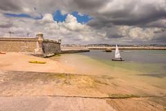 The threat (Sizun Eye) Tags: beach fortress town lagos algarve portugal sizuneye nikond750 nikon1424mmf28 nikkor cloudscape summer boat