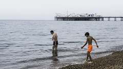 Brighton Beach - Father and Son (Joel_Goldstein) Tags: brighton beach father son quiet sony rx100 orange shorts water swim pier natural candid colours wet kids