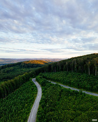 Sunset over the Vienna woods. (The Hobbit Hole) Tags: mavicpro road sunset mavic curve austria fromabove green vienna wienerwald droneshots wien