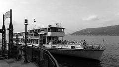 arriving at Santa Caterina (Carsten Weigel) Tags: carstenweigel monochrome italien italia italy lagomaggiore lombardia lombardei panasonicg9 leicasummilux12mmf14 ship boat schiff fähre ferry boot schwarzweiss