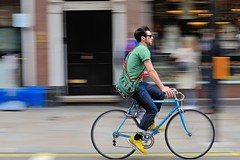 Vintage bike, ethnic bag (jeremyhughes) Tags: london street cyclist cycling bicycle bike rider riding speed motion movement panning city urban blue ethnic transport road shades nikon d700 sigma 70200mmf28exapoifhsm 70200mmf28 ethnicbag patterns patterned