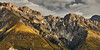 Tasman Valleys (Scintt) Tags: newzealand landscape surreal epic dramatic light glow orange yellow golden vibrant peaceful quiet calm early clouds sky sun patterns texture nature natural mountains clear tourism travel scintillation scintt jonchiangphotography sunset evening twilight valley mountcook aorakinationalpark boardwalk path hike grass field bushes morning dawn blue reallyrightstuff tripod park patch barren tasman dusk exploration telephoto cliff mountainside panorama