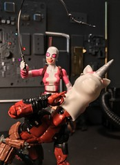 GP: Someone has been a naughty unicorn. Time for the whip!                  DP: She gets me. She really really gets me. (chevy2who) Tags: inch six marvellegends marvel toyphotography toy figure action gwenpool deadpool
