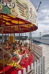 Carousel on Llandudno pier (Keartona) Tags: carousel colourful llandudno pier fairground wales northwales spring colours horses ride