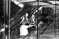 Going Up 2 (FunkyPepper) Tags: vancouver escalator goingup streetphotography streetwise candidstreetphotography reflection people woman candidshot photographer canada nikon d810 blackandwhite bw