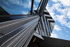 Reflecting the sky - New Horizon Buiding (Greenstone Girl) Tags: claytoncampus monashuniversity buildings geometry plants natives windows reflections sky blue clouds
