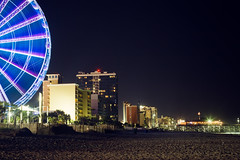 Skywheel Presence (matthewkaz) Tags: skywheel ferriswheel ocean atlanticocean lights beach sand night nightlights coast coastline buildings myrtlebeach longexposure sc southcarolina 2017 pier