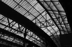 glass ceiling (amazingstoker) Tags: glass waterloo roof ceiling architecture london station railway girder scaffold support england transport monochrome black white dusk evening mobile phone