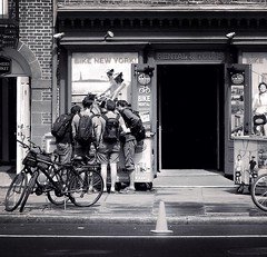 Huddle (Demmer S) Tags: street streetphotography people pedestrian peoplewatching shootthestreet streetlife streetshots documentary candid candidstreet citylife person urban city outside urbanphotography streetscene urbanexploration outdoors bikes bicycles rental tour shop store retail business group kids boys huddle planning investigating curiosity kid boy backpacks bike bicycle ny newyork nyc newyorkcity manhattan eastcoast downtownmanhattan downtownnewyork lowermanhattan financialdistrict bw monochrome blackwhite blackandwhite blackwhitephotos blackwhitephoto rent tours curious building