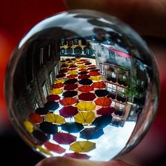 Umbrella Alley at Place Royal (Irena_ka) Tags: canada quebeccity oldcity square umbrellas dof