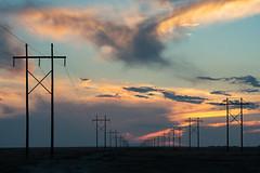 The Power of Sunset - Pueblo West, CO (Christopher J May) Tags: goldenhour electricity powerlines nikonafnikkor80200mmf28d nikond800 co colorado sunset landscape pueblowest