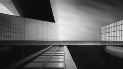 Delftse Architecture (frank_w_aus_l) Tags: rotterdam sky city skyscraper netherlands holland sw monochrome noiretblanc netb nikon d850 nikkor longexposure fineart delftsepoort architecture architektur blackandwhite schwarzweis reflection facade zuidholland niederlande nl 2470