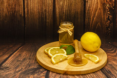 Golden honey in a jar, lemon slices and lemon leaves on a wooden plate on wooden background (zaklina.miljkovic) Tags: aroma aromatherapy background closeup color condiment delicious dessert dipper flavor food fresh glass gold golden green healthy herb home honey ingredient jar leaves lemon liquid medicine natural nutrition organic plate product products slices sweet texture wood wooden yellow