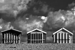 (a_radical_eye) Tags: beachhuts beach hut clouds cloudy stormy breakingcloud canon 100mm prime shingle 2ndsightphotography bw blackandwhite monochrome haylingisland uk aradicaleye