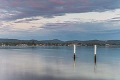 Cloudy Reverse Sunrise Waterscape over the Bay (Merrillie) Tags: daybreak blackwall landscape nature bay mountains clouds earlymorning morning brisbanewater sthubertsisland woywoy coastal newcastle outdoors waterscape australia centralcoast sunrise water