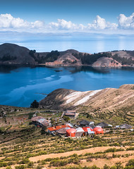 Isla del Sol (ThibaultPoriel) Tags: isladelsol isla island île bolivie bolivia travel southamerica islands blue sun lactiticaca titicaca colors light daylight outdoors discover houses landscape clouds