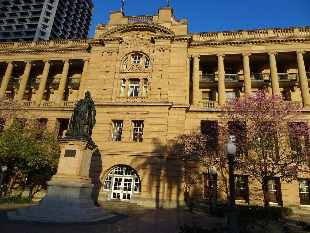 Brisbane. The Lands Administration building. Built from 1899 to 1905. A statue of Queen Victoria is in frontn of it. Built in golden coloured sandstone.