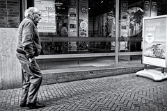 I'm A Traveller (Alfred Grupstra) Tags: blackandwhite people urbanscene men street england uk editorial city citylife outdoors famousplace europe store britishculture males cultures oldfashioned