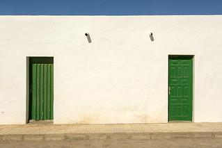 Two green doors