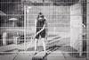 behind bars (Zesk MF) Tags: bars minigolf lines zesk black white mono play spiel schläger golf ball zaun summer outside fence woman