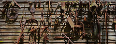 Farm Implements (davidwilliamreed) Tags: old rusty crusty metal farm implements agricultural tools weathered wood siding barn rustic patina textures shadows rust decay