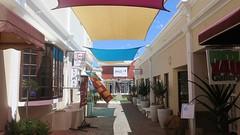 Hermanus, art galleries (Sokleine) Tags: hermanus westerncape southafrica afriquedusud africa afrique galerie galleries allée lane shop sculpture statue flowerpots sails voiles