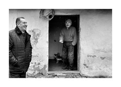 (Jan Dobrovsky) Tags: carpathians portrait smile people reallife outdoor door countryside monochrome cigarette house dog blackandwhite leicaq ukraine village countrylife document