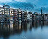Damrak (DinoPozo) Tags: amasterdam canales europe netherlands waterway buildings reflections cityscapes cityshots bluehour canon canonteam longexposure