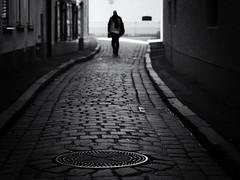 way home (Sandy...J) Tags: olympus oldtown monochrom fotografie noir atmosphere alone atmosphäre allein altstadt blackwhite bw black city cobblestones deutschland germany photography man mono mann walking white blur blurred street streetphotography sw schwarzweis strasenfotografie stadt silhouette shadow light urban walk strase stimmung mood monochrome