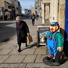 Lego man (halifaxlight) Tags: england gloucestershire cirencester cotswolds street lego woman pedestrians sunny shadows square sign