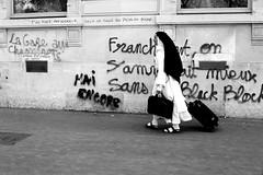 After black blocks had left (pascalcolin1) Tags: paris13 austerlitz femme woman soeur sister blackblocks mur wall manif graffiti graffito photoderue streetview urbanarte noiretblanc blackandwhite photopascalcolin 50mm canon50mm canon