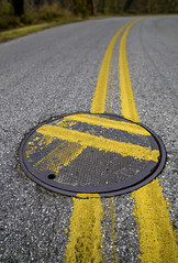 OCD Test. (crabsandbeer (Kevin Moore)) Tags: manhole manholecover road street stripe ocd curve traffic baltimore perfect imperfect mistake paint painter lazy asphalt lane stripes turn rotate circle