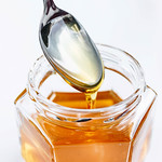 Golden Honey Pouring From The Spoon thumbnail
