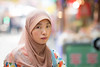 A chinese woman in the Muslim Quarter of Xi'An (leonardrodriguez) Tags: woman femme muslim musulman islam regard china chine cina 中国 上海 cinese chinois xian shaanxi sian 西安 beiyuanmen moslemmarket scarf