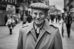 Ever The Optimist (Leanne Boulton) Tags: portrait hat people urban street candid portraiture streetphotography candidstreetphotography candidportrait streetportrait eyecontact candideyecontact streetlife old elderly man male eyes face smile smiling expression happiness happy dapper gentleman tone texture detail depthoffield bokeh naturallight outdoor light shade city scene human life living humanity society culture canon canon5d 5dmkiii 70mm ef2470mmf28liiusm black white blackwhite bw mono blackandwhite monochrome glasgow scotland uk