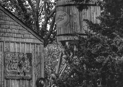 Water Tank (Tim @ Photovisions) Tags: tank monochrome cocacola whizzer sign wood shed vintage nebraska blackandwhite watertank