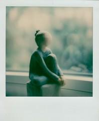 Homage a Kertesz (thereisnocat) Tags: polaroid sx70 polaroidoriginals figure figurine window