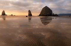 Parallel lines (debojit_dhar) Tags: cannon beach oregon coast haystack rock seaside sunset sand low tide reflection