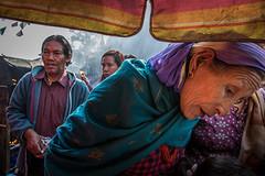 At Swayambhunath (puuuuuuuuce) Tags: swayambhunath ombrella pilgrim buddhism praying kathmandu nepal