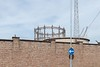 Gasometer (Number Johnny 5) Tags: lines tamron d750 nikon streetlamp industrial vintage space structure mundane post ironwork urban imanoot angles gasometer walls historic banal architecture pole 2470mm signs johnpettigrew documenting
