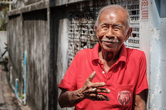 Relief in a cigarette (Goran Bangkok) Tags: bangkok thailand cigarette man sun sunlight red smoking smoker local community portrait