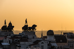 Sunset in Madrid (Adrià Páez) Tags: sunset roofs sculptures city capital madrid spain españa europe orange canon eos 7d mark ii