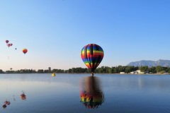 Touch Down (Patricia Henschen) Tags: balloonliftoff balloonclassic hotairballoon prospect lake memorialpark park prospectlake colorado coloradosprings downtown laborday labordayliftoff balloon balloons morning dawn reflection
