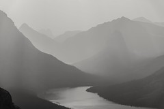Scenic view (derliebewolf) Tags: glaciernationalpark twomedicinelake scenicpoint scenic hiking backcountry backpacking backlight sunset mist goldenhour misty travel landscape nationalpark mountains continentaldivide crownofthecontinent lake hss sliderssunday mono montana rockies rockymountains blackandwhitelandscape blackandwhite bw