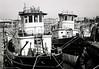 Redundant Tugboats (gwpics) Tags: ship england southampton craft shipping disused mono boat redundant archive marine sea analog analogue film hampshire hants leica monochrome bw blackwhite blackandwhite