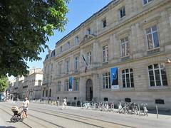 Crossing the tram line, university building at Place Pey Berland, Bordeaux, France (Paul McClure DC) Tags: bordeaux france gironde july2017 nouvelleaquitaine historic architecture people