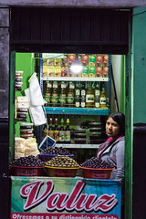 Olive stall (ghostwheel_in_shadow) Tags: america arequipa peru southamerica industryandcommerce market olive profession retail shopkeeper stall tradesman pe
