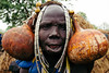 gourds (rick.onorato) Tags: africa ethiopia omo valley tribes tribal mursi woman gourds