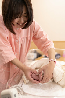 Mother making heart shape with baby's legs